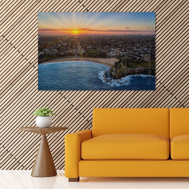 Coogee Beach Sunset  Available as Fine Art Print on Kess Gallery - https://info.kess.gallery/coogee-sunset  Aerial Drone Photo of Coogee with the Sydney CBD at Sunset in the Background.  