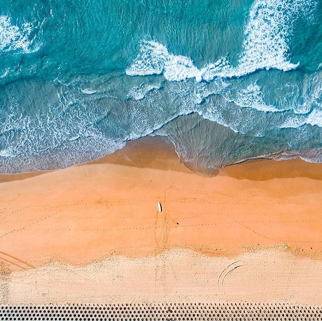 Honeycomb    ⁣ ⁣ Available as Fine Art Print on www.kess.gallery⁣ ⁣ Aerial shot taken over a section of the iconic 'Wall' at Cronulla Beach.  This image is all about layers as the honeycomb-concrete wall meets the sand.  Each layer of sand becomes deeper and rustier until finally merging with choppy green and white waves. ⁣ ⁣