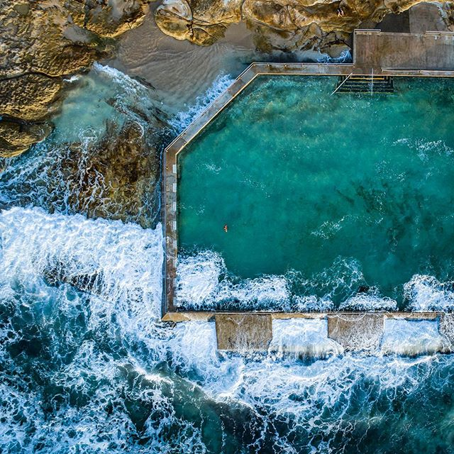 Wave Pool     Available as Fine Art Print on www.kess.gallery  Early morning aerial shot looking over Cronulla Rockpool. Look closely for the lone swimmer basking in the solitude.  